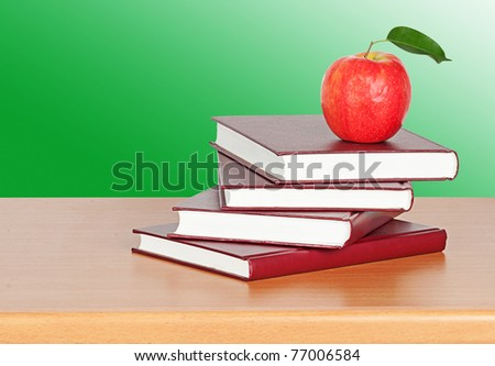 Red apple on  books - stock photo