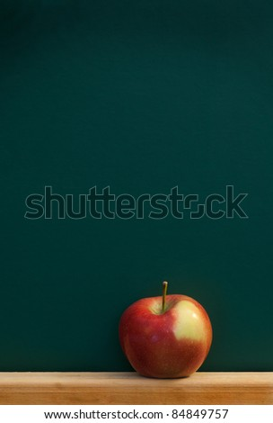 red apple on chalkboard, add text to chalkboard - stock photo
