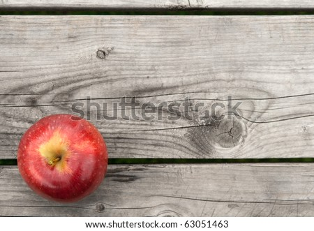 Red apple on gray old wooden table from above, with copy space. - stock photo