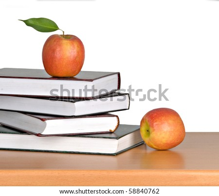 Red apple on open book