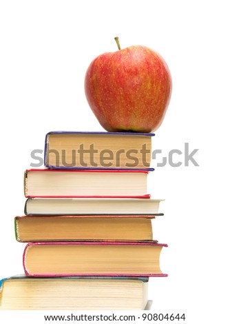 red apple on pile of books closeup on white background
