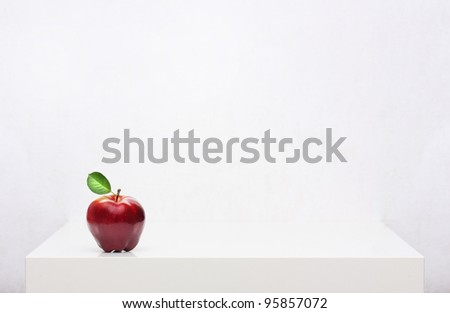 Red apple on the white shelf - stock photo