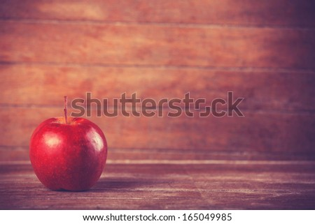 red apple on wooden table - stock photo