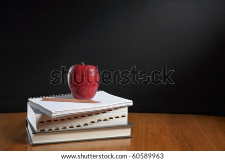 Red apple over pile of books for shool concept - stock photo