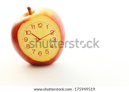 Red apple Slice Clock idea concept on the white background - stock photo