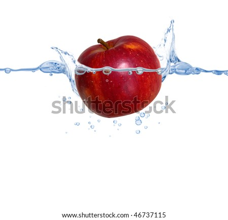 red apple thrown into the pure clear water - stock photo