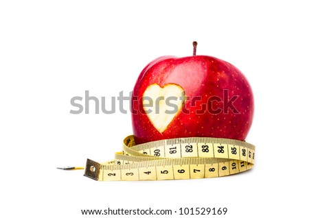 Red apple with a heart symbol against white background - stock photo