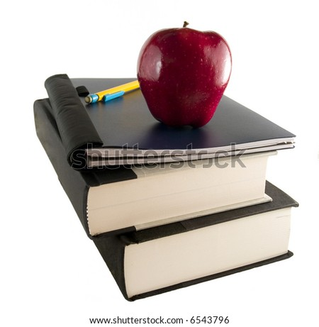 Red Apple with books and pencil - stock photo