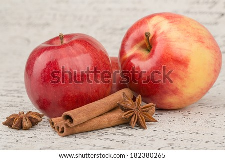 Red apple with cinnamon and anise stars
