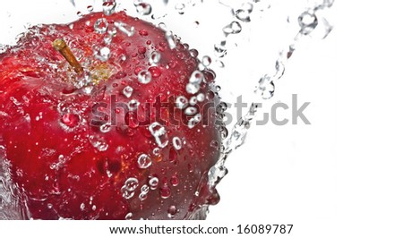 Red apple with drop of water isolated on white background