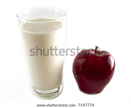 Red apple with glass of milk - stock photo
