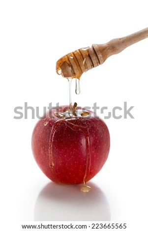 Red apple with honey dipper - stock photo