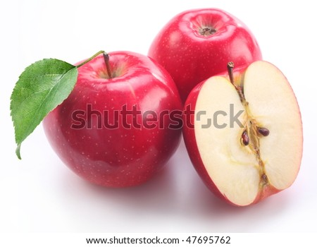 Red apple with leaf on a white background