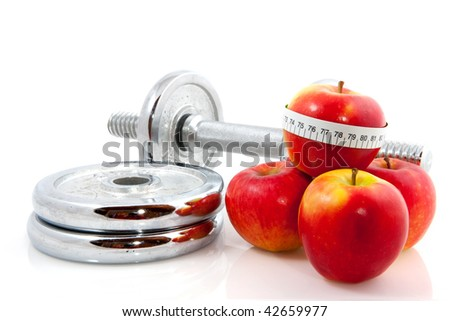 red apple with measure tape and dumbbells - stock photo