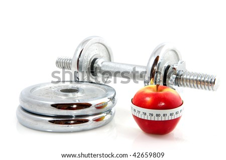 red apple with measure tape and dumbels - stock photo