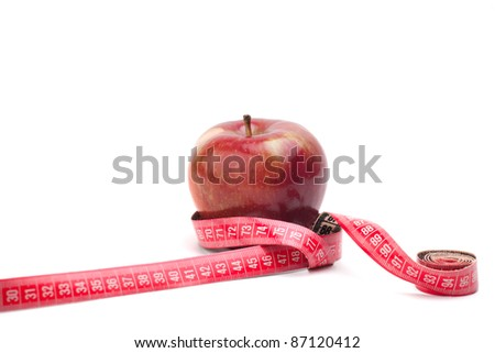 Red apple with measure tape around - stock photo
