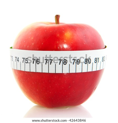 red apple with measure tape isolated over white