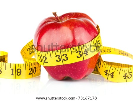 Red apple with measure tape on white background - stock photo