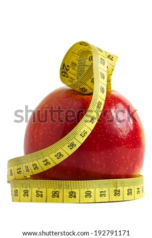 Red apple with measuring tape over white background - the concept of diet and fitness