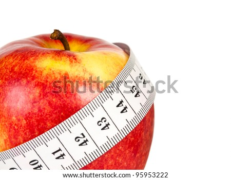 Red apple with tape measuring on white background (health and diet concept) - stock photo