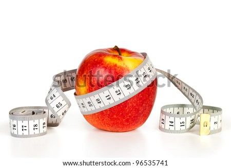 Red apple with tape measuring on white background (health and diet concept)