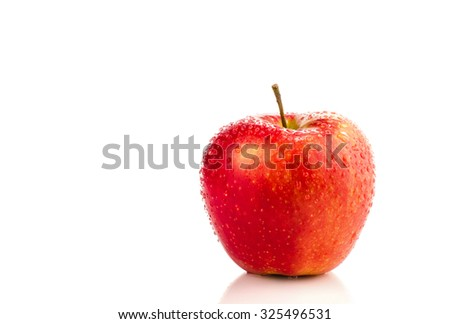 Red apple with water drops, isolated on white background