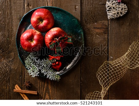 Red apples and Christmas decorations, texture