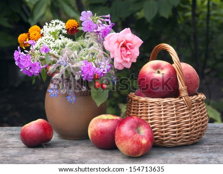 red apples and flowers still  life