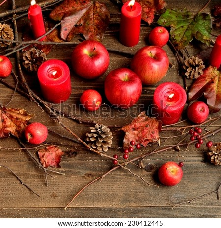 Red apples,autumn ivy leaves and red candles