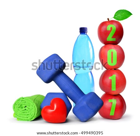 Red apples, dumbbells and PET bottle with drinking water isolated on white. Healthy resolutions for the New Year 2017