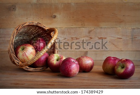 Red apples in a basket on a wooden background - stock photo