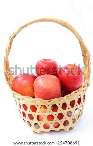 Red apples in bamboo baskets.