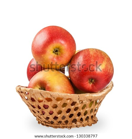 red apples in wicker basket isolated on white background