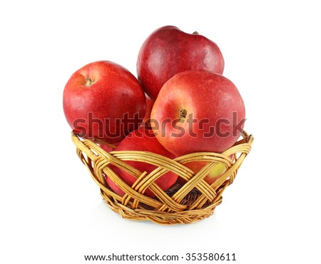 red apples lie in Wicker Bowl