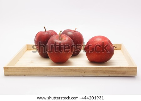red apples on tray wooden on white background