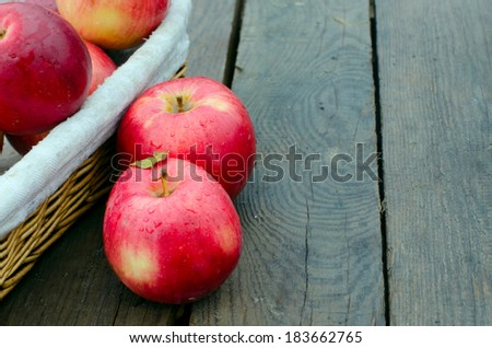 red apples on wood in a rainy day - stock photo