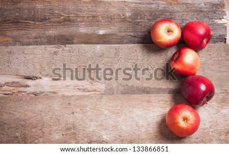 red apples on wooden background - stock photo