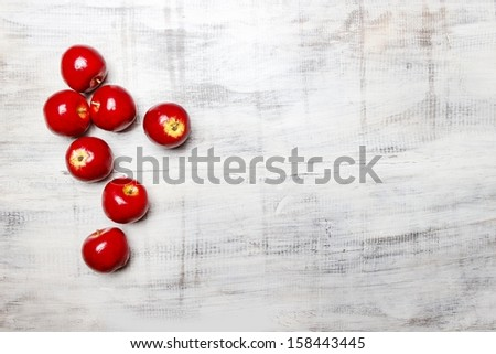 Red apples on wooden background. Copy space. - stock photo