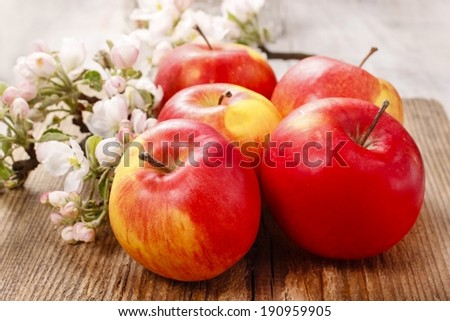 Red apples on wooden table - stock photo