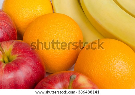 Red apples, oranges and bananas
