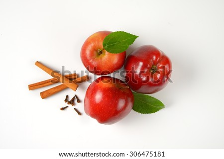 red apples with leaves and spice on white background - stock photo