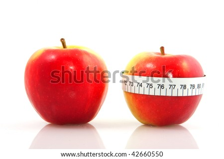 red apples with measure tape isolated over white