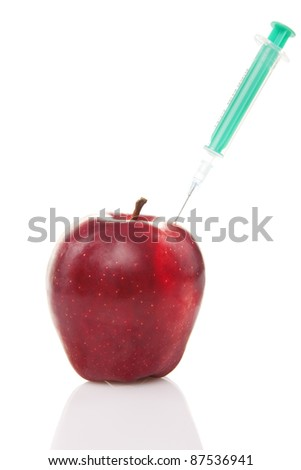 red apples  with syringe injected isolated on white background