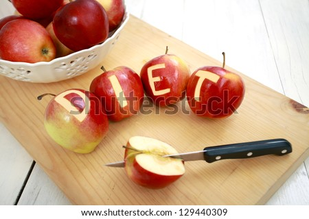 Red apples with the word diet engraved on them