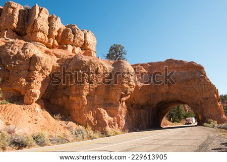 Red Arch road tunnel on the way to Bryce Canyon - stock photo