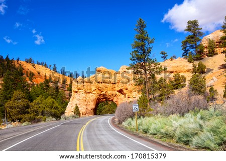 Red Arch road tunnel on the way to Bryce Canyon National Park, Utah, USA