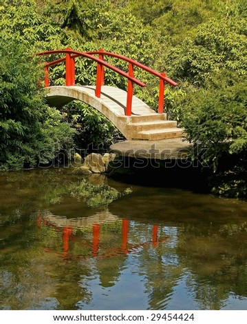 Red Arched Japanese Bridge with Reflection in Pond
