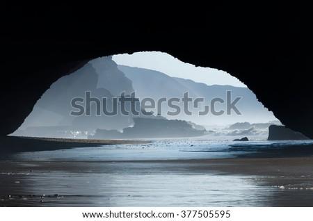Red archs on atlantic ocean coast - stock photo