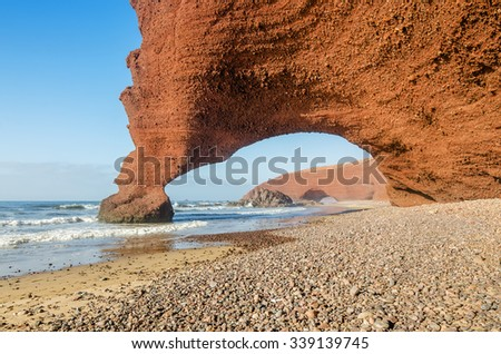 Red archs on atlantic ocean coast in Marocco, Legzira beach