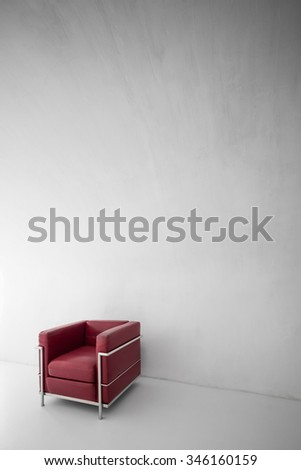 red armchair in a minimalist interior - stock photo